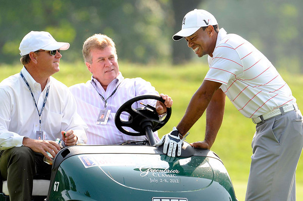 Tiger Woods, right, talks with Dillard Pruitt, rule official PGA Tour, left, and Slugger White, VP of rules and competitions, during The Greenbrier Classic Pro-Am held on The Old White TPC course.<br /> Rick Barbero/The Register-Herald