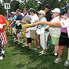 John Daly signs autographs after playing the 11th hole during The Greenbrier Classic Pro-Am held on The Old White TPC course.<br /> Rick Barbero/The Register-Herald