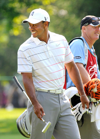 Tigers Woods walking of the 11th green during The Greenbrier Classic Pro-Am held on The Old White TPC course.<br /> Rick Barbero/The Register-Herald