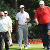 Tiger Woods, center, walks down the 12th fairway with Jay Justice, left, and Jim Justice, during The Greenbrier Classic Pro-Am held on The Old White TPC course.<br /> Rick Barbero/The Register-Herald