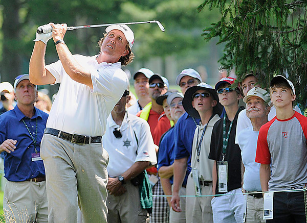 Phil Mickelson watches his shot on the 9th hole during The Greenbrier Classic Pro-Am held on The Old White TPC course.<br /> Rick Barbero/The Register-Herald