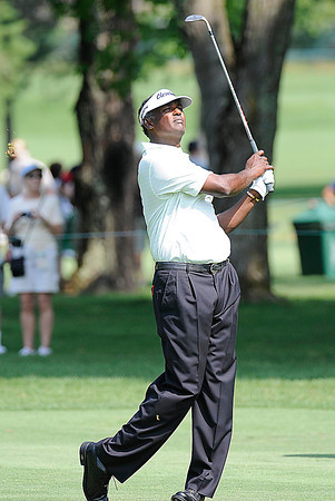 Vijay Singh watches his shot from the 7th fairway during The Greenbrier Classic Pro-Am held on The Old White TPC course.<br /> Rick Barbero/The Register-Herald