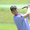 Webb Simpson hits a shot on the 8th hole during The Greenbrier Classic Pro-Am held on The Old White TPC course.<br /> Rick Barbero/The Register-Herald