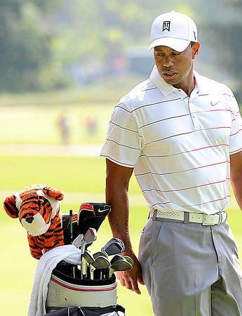 Tiger Woods looking at his bag during The Greenbrier Classic Pro-Am held on The Old White TPC course.<br /> Rick Barbero/The Register-Herald