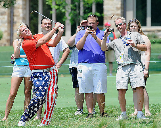 John Daly hits his second shot on the 10th hole during The Greenbrier Classic Pro-Am held on The Old White TPC course.<br /> Rick Barbero/The Register-Herald