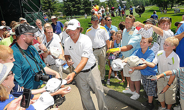 Phil Mickelson signing autographs during The Greenbrier Classic Pro-Am held on The Old White TPC course.<br /> Rick Barbero/The Register-Herald