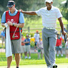 Tiger Woods, right, laughs with his caddy during The Greenbrier Classic Pro-Am held on The Old White TPC course.<br /> Rick Barbero/The Register-Herald