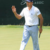 Johnathan Byrd waves after he made a birdie on the 18th hole during  the second round of The Greenbrier Classic.<br /> Rick Barbero/The Register-Herald