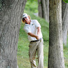 Charley Hoffman hits behind some trees on the 13th hole during  the second round of The Greenbrier Classic.<br /> Rick Barbero/The Register-Herald