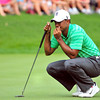 Tiger Woods looks over the green on the 9th hole during the second round of The Greenbrier Classic. Chris Tilley/The Register-Herald