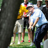 Davis Love lll hits his second shot from behind a tree on 17th hole during  the second round of The Greenbrier Classic.<br /> Rick Barbero/The Register-Herald