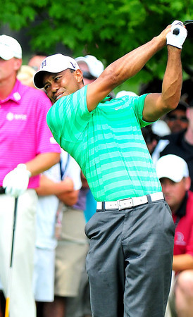 Tiger Woods tees off  on the 9th hole during the second round of The Greenbrier Classic. Chris Tilley/The Register-Herald