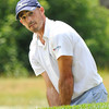 Johnathan Byrd hits out of the trap on the 13th hole during  the second round of The Greenbrier Classic.<br /> Rick Barbero/The Register-Herald