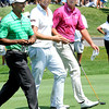 Tiger Woods, left, Webb Simpson and Steve Stricker walk the 9th fairway during  the second round of The Greenbrier Classic.<br /> Rick Barbero/The Register-Herald