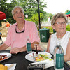 Bucky and Ann Harkins, of Beckley, enjoying themselves in the alumni hospitality area for WVU, Marshall, Virginia Tech and UVA,  during the third round of The Greenbrier Classic.<br /> Rick Barbero/The Register-Herald