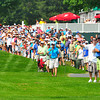 Specters follow the play of Webb Simpson, Charlie Beljan and Jonathan Byrd on the 12th hole of the Greenbrier Classic on Saturday.Chris Tilley/The Register-Herald