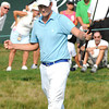 Webb Simpson reacts after making a birdie putt on the par 3, 18th hole during the third round of The Greenbrier Classic. Simpson is the leader by two stoke at 14 under par.<br /> Rick Barbero/The Register-Herald