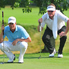 Webb Simpson left and Charlie Beljan right look over the green on the 16th hole during the Third-Round of play in The Greenbrier Classic on Saturday. Chris Tilley/The Register-Herald