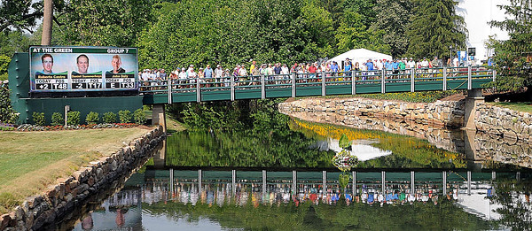 Spectators crossing bridge heading to 18th green hole during the third round of The Greenbrier Classic.<br /> Rick Barbero/The Register-Herald