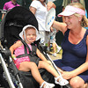 Lindsey Egge, of Arlington, Va., fans her daughter Juliana Egge trying to keep her cool during the third round of The Greenbrier Classic.<br /> Rick Barbero/The Register-Herald