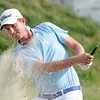 Webb Simpson hits out of the sand trap on the 17th hole during the third round of The Greenbrier Classic. Simpson is 14 under par with a two stroke lead.<br /> Rick Barbero/The Register-Herald