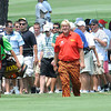John Daly walking up the 11th fairway with a large crowd following him during the third round of The Greenbrier Classic.<br /> Rick Barbero/The Register-Herald