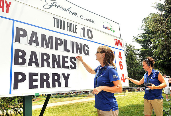 Tonya Maynard, left and Lisa Watts post scores during the third round of The Greenbrier Classic.<br /> Rick Barbero/The Register-Herald