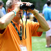 Bernie McGraner, of Charleston, looking at golfers coming up the 11th fairway during the third round of The Greenbrier Classic.<br /> Rick Barbero/The Register-Herald
