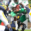 Andre Booker, 19, of Marshall, gains a few yards against WVU in the Friends of Coal Bowl game Saturday in Morgantown.<br /> Rick Barbero/The Register-Herald