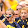 WVU fans cheer during the Friends of Coal Bowl game Saturday in Morgantown.<br /> Rick Barbero/The Register-Herald