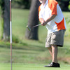 F. BRIAN FERGUSON/THE REGISTER-HERALD=Eric Scalf watches his putt un #9 during Saturday's opening round of the BNI at Grandview.