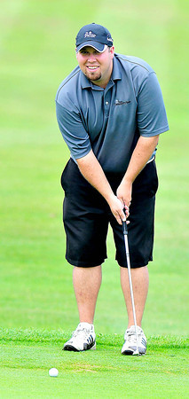Jeff Miller practices his putt on the 8th green  during the BNI Memorial Tournament on Saturday at Pipestem.