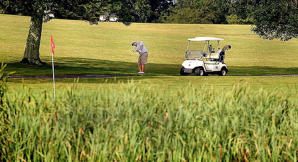 F. BRIAN FERGUSON/THE REGISTER-HERALD=Andrew Skeens chips onto #5 during Saturday's opening round of the BNI at Grandview.