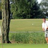 F. BRIAN FERGUSON/THE REGISTER-HERALD=David Crone chips onto #9 during Saturday's opening round of the BNI at Grandview.