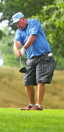 Jerry Hickman tees off on the 12th hole  drive during the BNI Memorial Tournament on Saturday at Pipestem.