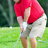 Alan Wharton chips onto the green of the 8th hole during the BNI Memorial Tournament on Saturday at Pipestem.