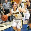 Lexi Tincher, of Greenbrier East, dribbles the away from Karlee Alderman, of Cabell Midland, during the quarter final game of the Girls State Basketball Tournament bin Charleston.<br /> Rick Barbero/The Register-Herald