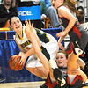Lexi Tincher, of Greenbrier East, tries to get away from two Cabell Midland defenders during the quarter final game of the Girls State Basketball Tournament in Charleston.<br /> Rick Barbero/The Register-Herald