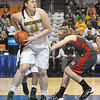 Sydney Nunley, of Greenbrier East, pulls down a rebound against Cabell Midland, during the quarter final game of the Girls State Basketball Tournament bin Charleston.<br /> Rick Barbero/The Register-Herald