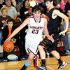 F. BRIAN FERGUSON/THE REGISTER-HERALD=Summers County's Jacob Carr, right, defends against Liberty's #23 during Thursday evening action in Glen Daniels.