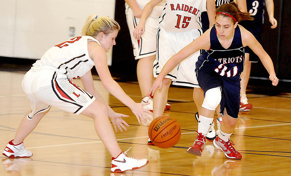 Independence High School Emily Fedukovich, steals the ball from Liberty's Katie McGinnisduring Mondays game at Liberty High School. Photo by Chris Tilley