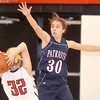 Independence High School Emily Fedukovich, jumps to block the pass of Liberty's Katie McGinnis, during Mondays game at Liberty High School. Photo by Chris Tilley