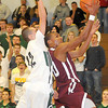 Wyoming East  Austin Canada, tries to contest the lay-in by Woodrow Wilson's Chase Hancock, during Tuesday nights game at Wyoming East High School. Photo By Chris Tilley