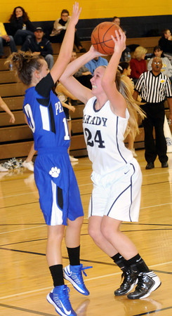 F. BRIAN FERGUSON/THE REGISTER-HERALD=Princeton's Maranda Wimmer guards Shady Spring's #24 during Thursday evening action.
