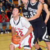 """F. BRIAN FERGUSON/THE REGISTER-HERALD=Oak Hill""""s Joey Re, left, goes for the hoop as as Westside's Justin Cogar, right, defends during Friday evening action in Oak Hill."""