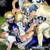 F. BRIAN FERGUSON/THE REGISTER-HERALD Shady Spring's Cody Lowe, Elliot Halstead, and Robby Perry stop James Monroe's ET Weiss during their Homecoming game with James Monroe.