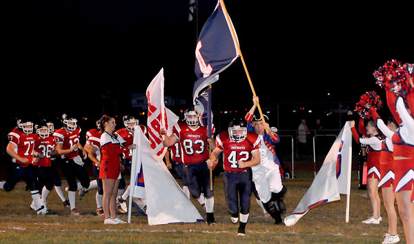 The Independence High School football team make their way on to the field Friday.