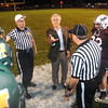 Homer Hickam flips the coin for the Woodrow Wilson vs Huntington game friday night at Van Meter Stadium in Beckley<br /> Rick Barbero/The Register-Herald
