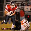 Independence Colton Ward runs the ball with Summers County Cody Harrah missing the tackle.