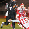 F. BRIAN FERGUSON/THE REGISTER-HERALD=Woodrow Wilson QB Andrew Johnson runs for a touchdown as Parkersburg's Aaron Roberts tries to make the tackle during Friday evening action in Beckley.